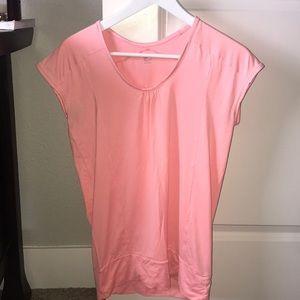 a pink, gapfit, workout top.